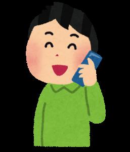 携帯で話している人の画像