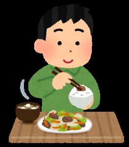 おかずを食べている人の画像