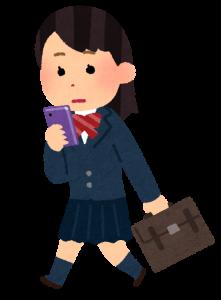 歩きスマホをしている女子高生の画像
