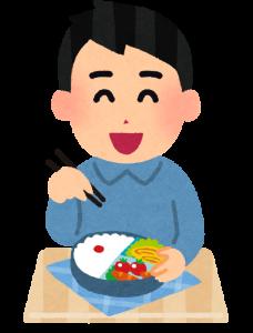 喜んで弁当を食べる人の画像