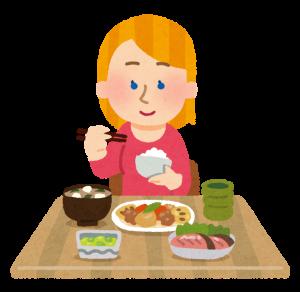和食を食べる英国人の画像